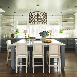 Inspiration for a large cottage u-shaped dark wood floor and brown floor kitchen remodel in Birmingham with an undermount sink, shaker cabinets, gray cabinets, quartz countertops, stainless steel appliances, an island and white countertops