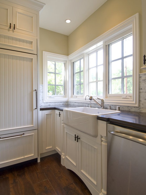 elegant kitchen photo in san francisco with paneled appliances a farmhouse sink recessed