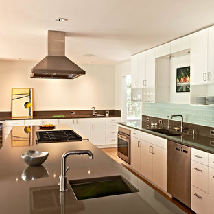 Kitchen - contemporary kitchen idea in Charlotte with stainless steel appliances and subway tile backsplash