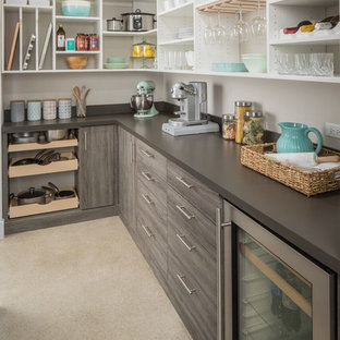 Contemporary kitchen pantry photos - Inspiration for a contemporary l-shaped gray floor kitchen pantry remodel in Nashville with open cabinets, white cabinets, stainless steel appliances and brown countertops