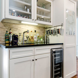 Mid-sized transitional medium tone wood floor eat-in kitchen photo in Dallas with an undermount sink, shaker cabinets, white cabinets, beige backsplash, quartz countertops, stainless steel appliances and an island