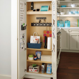 Design ideas for a classic l-shaped kitchen pantry in Other with medium hardwood flooring, white worktops, recessed-panel cabinets, beige cabinets and white splashback.