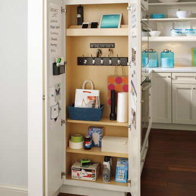 Elegant l-shaped medium tone wood floor kitchen pantry photo in Other with white countertops, recessed-panel cabinets, beige cabinets and white backsplash