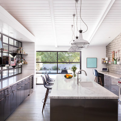 Inspiration for a large mid-century modern galley kitchen remodel in Los Angeles with an undermount sink, flat-panel cabinets, gray cabinets, multicolored backsplash, stainless steel appliances and an island