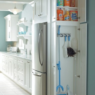 Small elegant ceramic floor kitchen pantry photo in Other with white cabinets