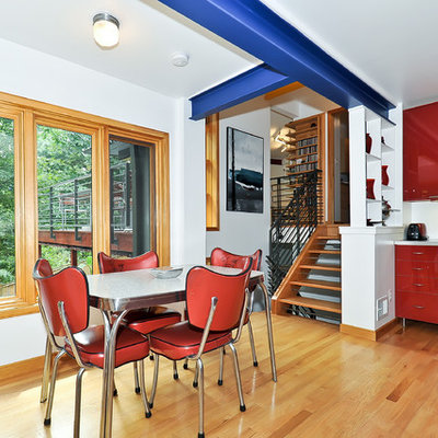Trendy eat-in kitchen photo in DC Metro with flat-panel cabinets, red cabinets and stainless steel appliances