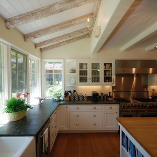 Inspiration for an eclectic kitchen in Austin with soapstone benchtops.