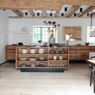 Large rustic eat-in kitchen photos - Example of a large mountain style galley painted wood floor eat-in kitchen design in Copenhagen with flat-panel cabinets, medium tone wood cabinets, two islands, a drop-in sink and wood countertops