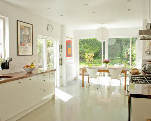 Contemporary White Floor Eat In Kitchen Idea In Other With Subway Tile  Backsplash, An