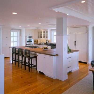 Example of a classic kitchen design in Boston with a farmhouse sink and wood countertops