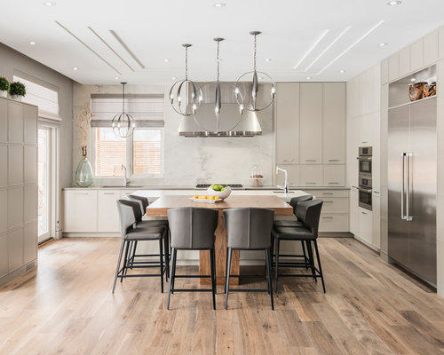 Example Of A Trendy L Shaped Kitchen Design In Ottawa With Flat Panel Cabinets