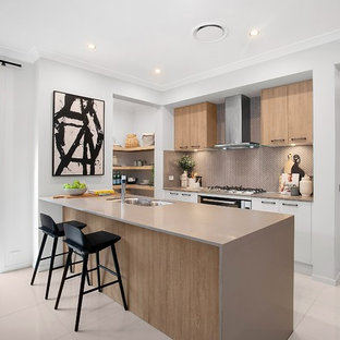 Inspiration for a contemporary galley kitchen in Sydney with a double-bowl sink, flat-panel cabinets, medium wood cabinets, brown splashback, stainless steel appliances, a peninsula, white floor and brown benchtop.