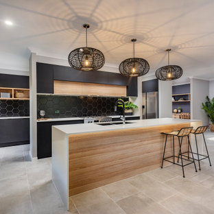 Design ideas for a mid-sized contemporary galley open plan kitchen in Sunshine Coast with an undermount sink, black splashback, with island and grey floor.