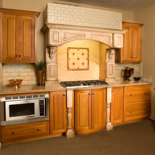 Small mediterranean enclosed kitchen ideas - Example of a small tuscan galley carpeted enclosed kitchen design in San Francisco with an undermount sink, raised-panel cabinets, light wood cabinets, quartz countertops, brown backsplash, ceramic backsplash, stainless steel appliances and no island