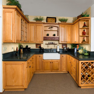 Inspiration for a small traditional u-shaped separate kitchen in San Francisco with a farmhouse sink, raised-panel cabinets, light wood cabinets, concrete benchtops, green splashback, cement tile splashback, stainless steel appliances, carpet and no island.