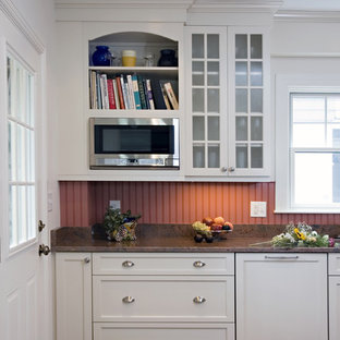 Small traditional kitchen pantry appliance - Small elegant l-shaped dark wood floor kitchen pantry photo in Boston with an undermount sink, beaded inset cabinets, white cabinets, granite countertops, red backsplash, ceramic backsplash, stainless steel appliances and no island