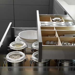 Eat-in kitchen - mid-sized contemporary u-shaped eat-in kitchen idea in Boston with an undermount sink, flat-panel cabinets, quartz countertops, stainless steel appliances and an island