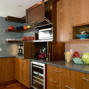 Photo of an expansive contemporary u-shaped eat-in kitchen in Boston with open cabinets, dark wood cabinets, concrete benchtops, stainless steel appliances, an undermount sink, dark hardwood floors and with island.