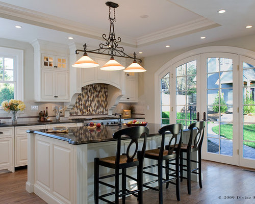 Large Elegant L Shaped Light Wood Floor Eat In Kitchen Photo In Boston With