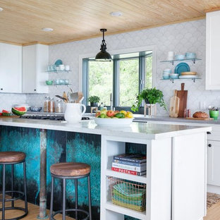 Inspiration for a large beach style l-shaped eat-in kitchen in Orlando with white splashback, ceramic splashback, bamboo floors, open cabinets, with island, concrete benchtops, white cabinets and beige floor.