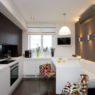 Trendy l-shaped eat-in kitchen photo with an undermount sink, flat-panel cabinets, dark wood cabinets, black backsplash and glass sheet backsplash