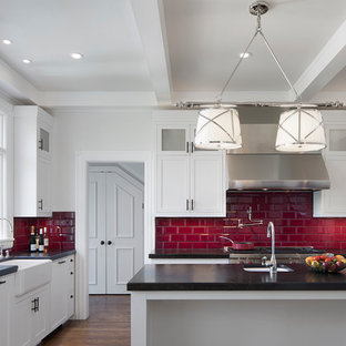 Design ideas for a large traditional u-shaped separate kitchen in San Francisco with a farmhouse sink, shaker cabinets, white cabinets, quartz benchtops, red splashback, subway tile splashback, stainless steel appliances, dark hardwood floors, with island and brown floor.