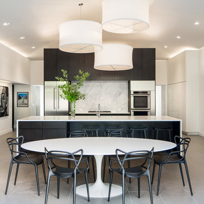 Eat-in kitchen - large contemporary galley eat-in kitchen idea in Denver with flat-panel cabinets, quartz countertops, white backsplash, stone slab backsplash, stainless steel appliances and an island