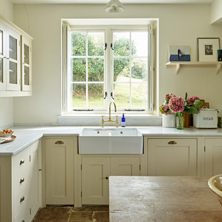 Medium sized country l-shaped open plan kitchen in Dorset with a belfast sink, shaker cabinets, yellow cabinets, marble worktops, grey splashback, marble splashback, integrated appliances, limestone flooring, an island, grey floors and grey worktops.