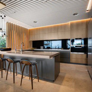 Inspiration for a large contemporary u-shaped eat-in kitchen in Sydney with flat-panel cabinets, brown benchtop, an undermount sink, medium wood cabinets, black splashback, glass sheet splashback, panelled appliances, a peninsula and beige floor.