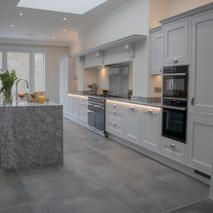 Dove grey kitchen with granite surfaces in Victorian townhouse