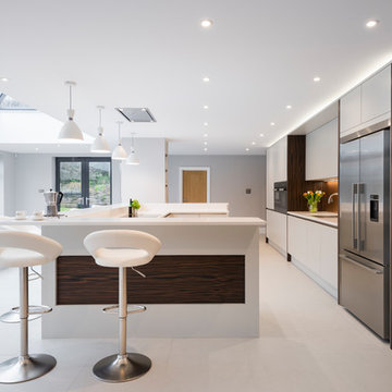 Dove Grey kitchen with timber detail and impressive U-shaped island