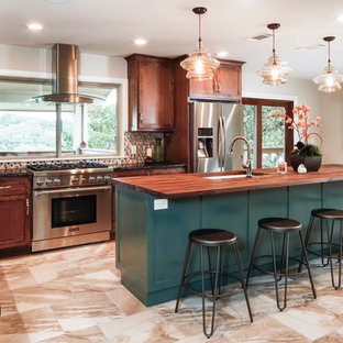 This is an example of a large transitional l-shaped open plan kitchen in Austin with an undermount sink, shaker cabinets, turquoise cabinets, wood benchtops, multi-coloured splashback, glass tile splashback, stainless steel appliances, travertine floors and with island.