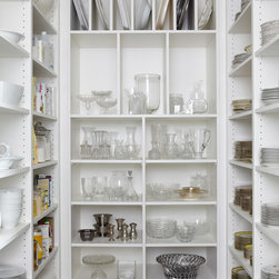 Downtown Escape - A walk in pantry with ample storage becomes customizable to the clients needs with adjustable shelving. This accommodates different sizes of fragile items the client owns and becomes a beautiful walk in display.