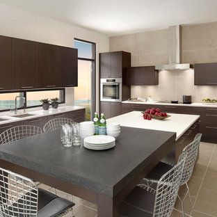 Large contemporary eat-in kitchen ideas - Inspiration for a large contemporary u-shaped porcelain floor eat-in kitchen remodel in Detroit with an undermount sink, flat-panel cabinets, dark wood cabinets, quartz countertops, stainless steel appliances, an island and beige backsplash