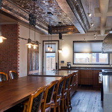 Industrial Kitchen by Rock Cliff Custom Homes