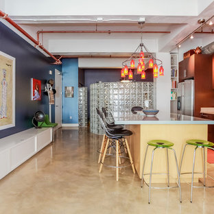 This is an example of an eclectic kitchen in Los Angeles with an undermount sink, flat-panel cabinets, medium wood cabinets, zinc benchtops, green splashback, ceramic splashback, stainless steel appliances, concrete floors and with island.