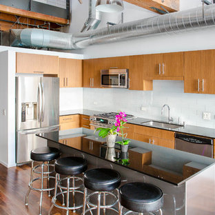 Mid-sized industrial kitchen appliance - Example of a mid-sized urban kitchen design in Los Angeles with an undermount sink, white backsplash and stainless steel appliances