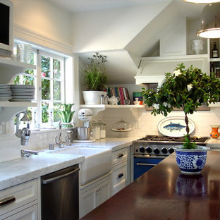 Small traditional eat-in kitchen designs - Inspiration for a small timeless l-shaped dark wood floor, brown floor and vaulted ceiling eat-in kitchen remodel in San Francisco with a farmhouse sink, white cabinets, white backsplash, subway tile backsplash, beaded inset cabinets, marble countertops, stainless steel appliances, an island and white countertops