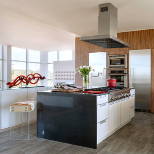 Large contemporary eat-in kitchen ideas - Large trendy porcelain tile and beige floor eat-in kitchen photo in Other with flat-panel cabinets, quartz countertops, stainless steel appliances, two islands, an undermount sink and white cabinets