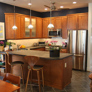 Mid-sized traditional eat-in kitchen inspiration - Eat-in kitchen - mid-sized traditional l-shaped ceramic floor eat-in kitchen idea in Philadelphia with stainless steel appliances, soapstone countertops, a single-bowl sink, shaker cabinets, beige backsplash, ceramic backsplash and an island
