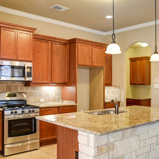 Traditional Kitchen by Omega Builders