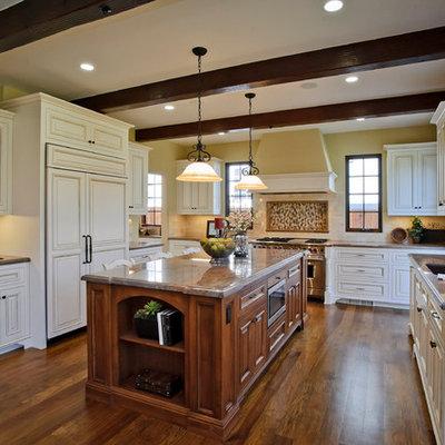 Example of a classic kitchen design in San Francisco with raised-panel cabinets, white cabinets, beige backsplash, subway tile backsplash and paneled appliances
