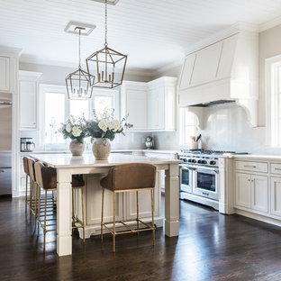 Traditional kitchen pictures - Inspiration for a timeless l-shaped dark wood floor and brown floor kitchen remodel in Charlotte with shaker cabinets, white cabinets, yellow backsplash, stone slab backsplash, stainless steel appliances, an island and white countertops