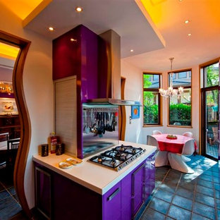 Design ideas for a large eclectic galley eat-in kitchen in Other with flat-panel cabinets, limestone benchtops, white splashback, stainless steel appliances and a peninsula.