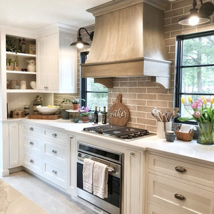Design ideas for a large country galley kitchen pantry in Other with a drop-in sink, shaker cabinets, white cabinets, quartz benchtops, beige splashback, ceramic splashback, stainless steel appliances, limestone floors, with island, grey floor and white benchtop.
