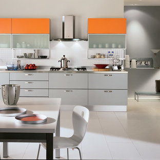 Large modern eat-in kitchen remodeling - Eat-in kitchen - large modern l-shaped ceramic tile eat-in kitchen idea in Melbourne with a double-bowl sink, raised-panel cabinets, orange cabinets, stainless steel countertops, white backsplash, ceramic backsplash, stainless steel appliances and two islands