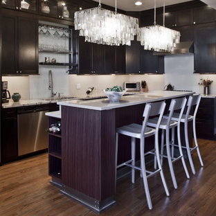 Mid-sized trendy l-shaped medium tone wood floor eat-in kitchen photo in Chicago with an undermount sink, recessed-panel cabinets, dark wood cabinets, marble countertops, white backsplash, glass tile backsplash, stainless steel appliances and an island