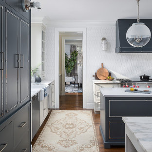 Inspiration for a large traditional kitchen in Chicago with a belfast sink, beaded cabinets, blue cabinets, marble worktops, white splashback, ceramic splashback, stainless steel appliances, medium hardwood flooring, multiple islands, brown floors and yellow worktops.