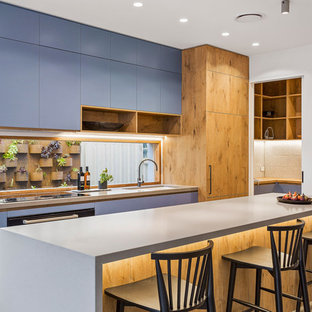 Mid-sized contemporary galley eat-in kitchen in Melbourne with an undermount sink, medium wood cabinets, concrete benchtops, window splashback, concrete floors, with island, grey floor, grey benchtop and flat-panel cabinets.