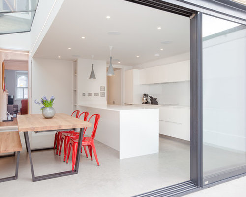 This Is An Example Of A Modern Single Wall Kitchen/diner In London With